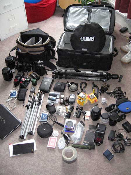 The contents of an old camera bag and flight case. My current one is subtly different, as it's a continually evolving process of choosing gear. Note also there are no personal effects visible — there's never much room for them!