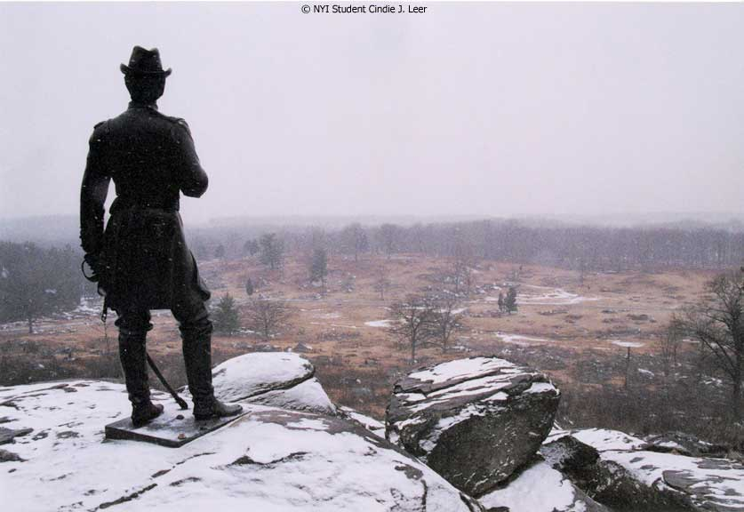 Statue in the Snow by NYIP Student Cindie J. Leer