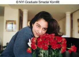 Woman with flowers photo by NYIP Graduate Smadar Kornfilt
