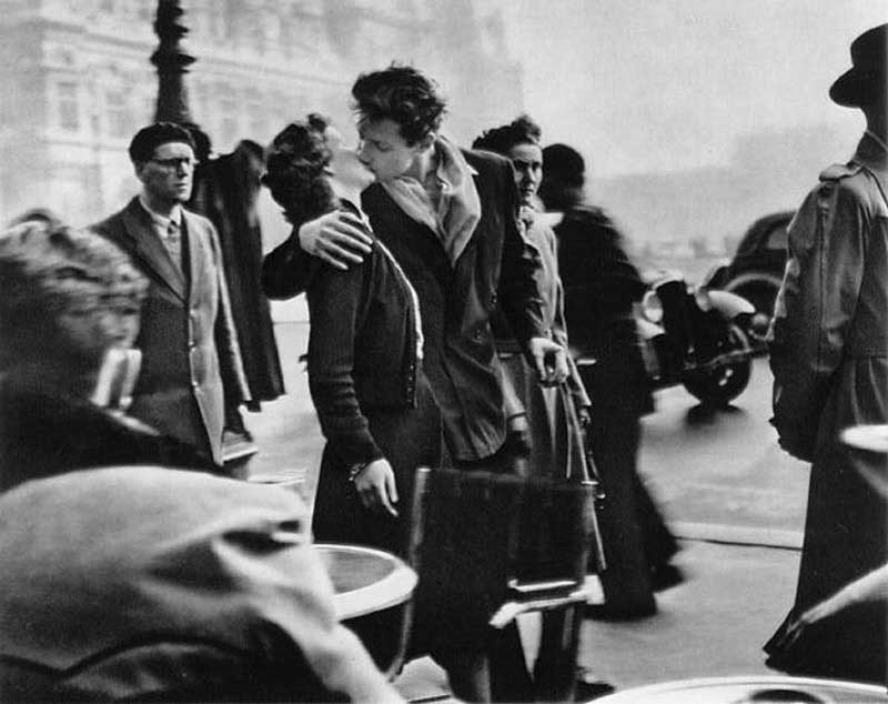 """The Kiss in Front of the Hotel de Ville"", by Robert Doisneau. It's grainy, very blurry in places, and there's a woman's head growing out of the man's shoulder, but that doesn't stop it being an awesome photo."